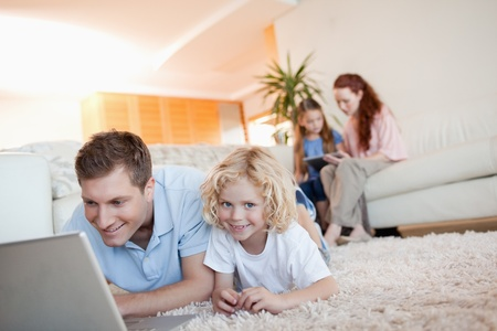 Father and son together with laptop on the floor Stock Photo - 11684199