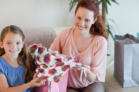 Mother and daughter on the sofa with their shopping photo