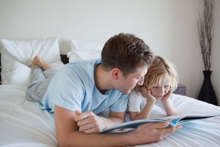 Father doing reading exercises together with his son Stock Photo - 11681161