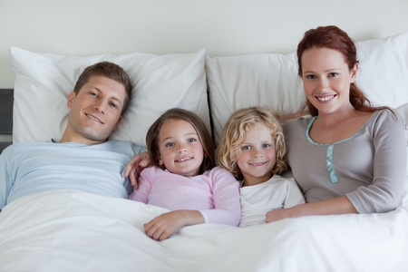 Young family sharing the bed photo