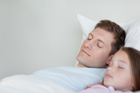 bedclothes: Father and daughter taking a nap next to each other