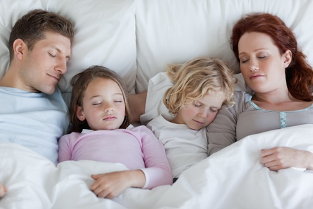 nap: Young family taking a rest together