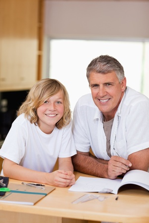 Father and son doing homework together photo