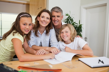 Family doing homework together Stock Photo - 11683382
