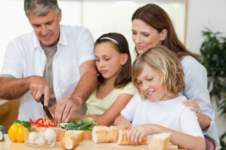 Family making sandwiches together photo