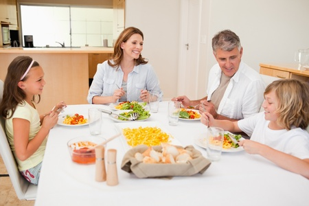 Family having a conversation together while dinner photo