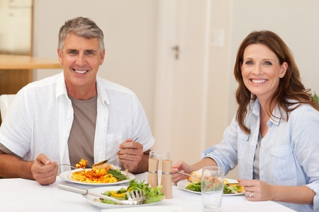 Smiling couple having dinner together photo