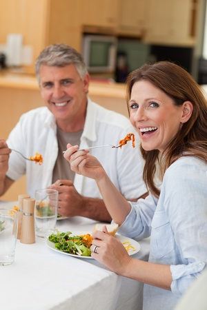 Happy smiling couple eating dinner together photo