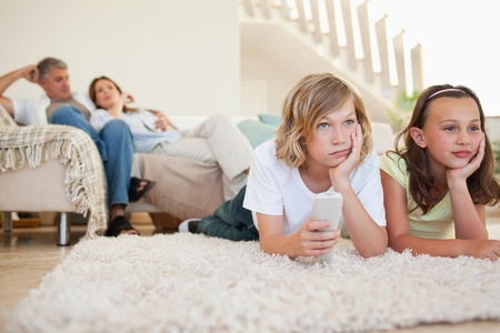 Siblings are bored by tv program photo