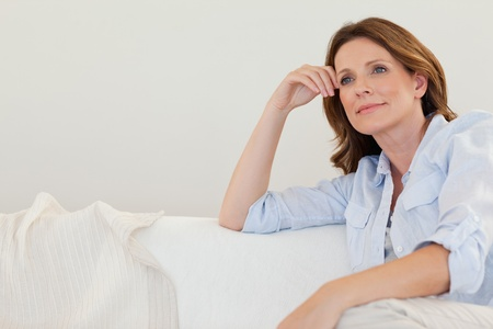 Mature woman in thoughts on the couch Stock Photo - 11685468