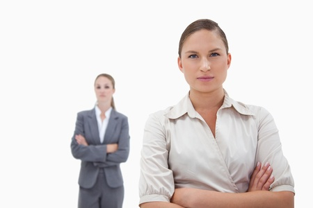 Two businesswomen posing against a white background photo
