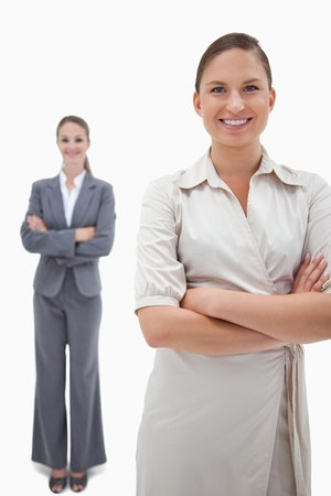Portrait of smiling businesswomen posing against a white background photo