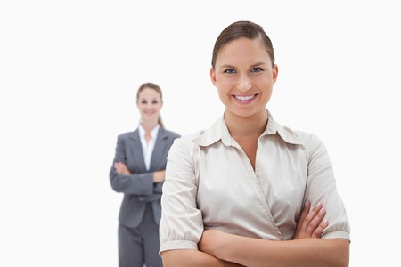 Smiling businesswomen posing against a white background photo