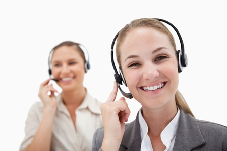 Happy operators using headsets against a white background Stock Photo - 11686685