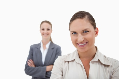 Sales persons posing against a white background photo
