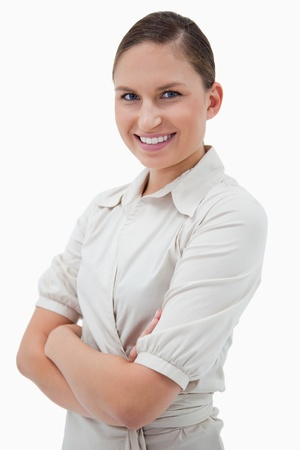 Portrait of a businesswoman with the arms crossed against a white background Stock Photo - 11686985