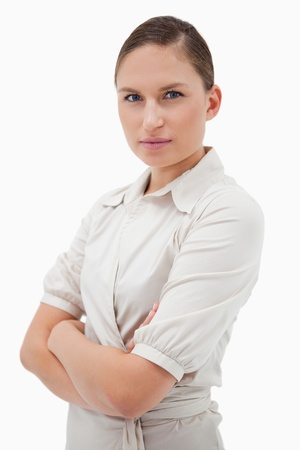 Portrait of a serious businesswoman with the arms crossed against a white background Stock Photo - 11686977