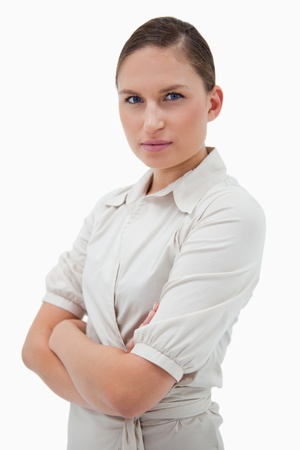 Portrait of a young businesswoman with the arms crossed against a white background Stock Photo - 11687017