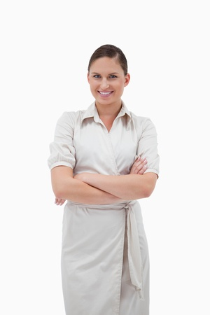 Portrait of a smiling businesswoman posing with the arms crossed against a white background Stock Photo - 11687347