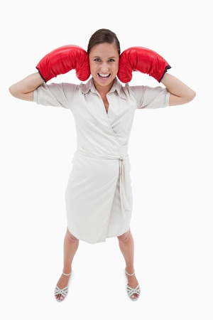 Portrait of a businesswoman with boxing gloves against a white background photo
