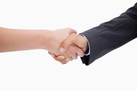 Close up of a handshake against a white background photo