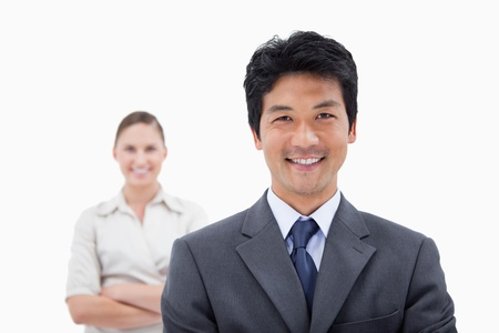Smiling business people posing against a white background photo