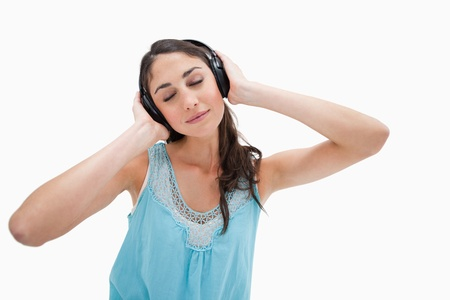 Woman listening to music against a white background Stock Photo - 11687132