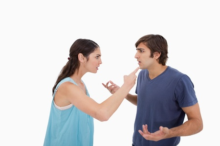 couple arguing: Young couple arguing against a white background