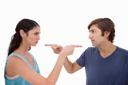 argument from love: Couple mad at each other against a white background