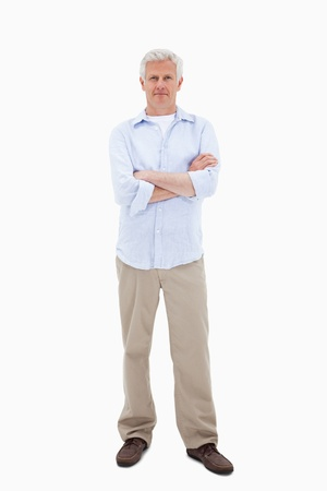 standing man: Mature man standing up against a white background Stock Photo