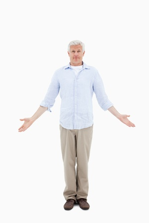 Portrait of a confused mature man against a white background Stock Photo - 11687559