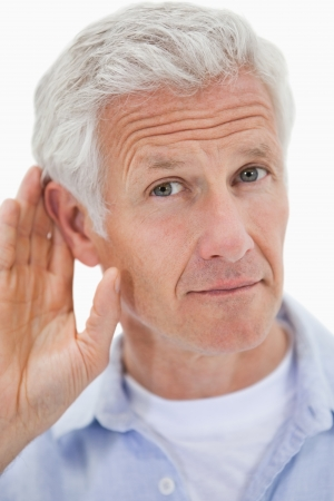 the deaf: Portrait of a man giving his ear against a white background