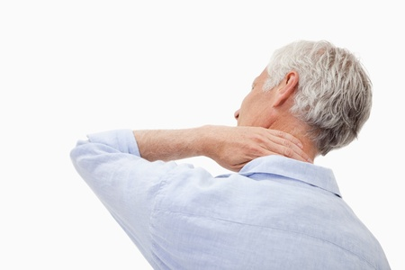 Mature man having a neck pain against a white background photo