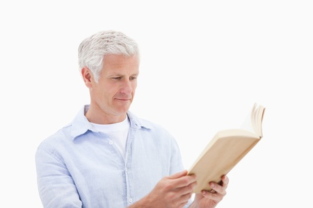 Man reading a book against a white background photo