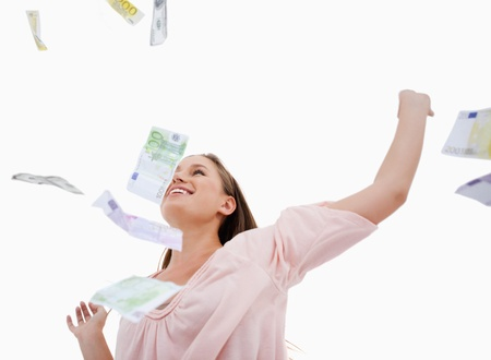 Woman under bank notes falling against a white background photo