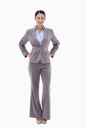 Portrait of a businesswoman with the hands on her hips against a white background Stock Photo - 11687341