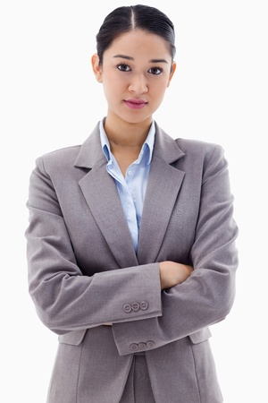 Portrait of a serious brunette businesswoman posing with the arms crossed against a white background Stock Photo - 11683581
