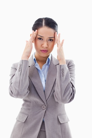 Portrait of a gorgeous businesswoman having a headache against a white background Stock Photo - 11685872