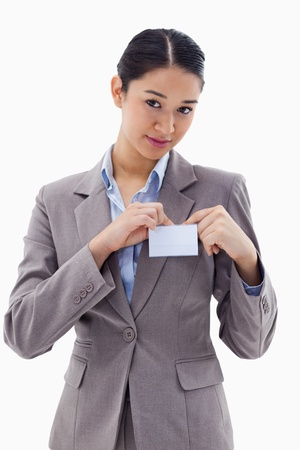 Portrait of a young businesswoman clipping her badge against a white background Stock Photo - 11685369