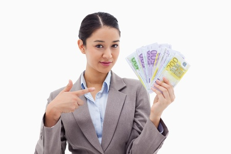 Businesswoman holding bank notes against a white background Stock Photo - 11686716