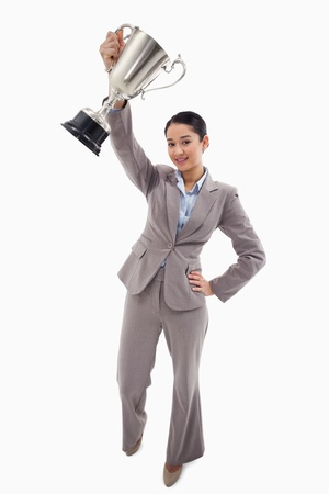 Portrait of a businesswoman showing a cup against a white background photo