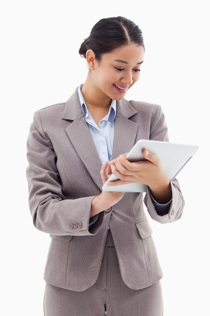 Portrait of a businesswoman using a tablet computer against a white background photo