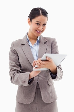 Portrait of a smiling businesswoman using a tablet computer against a white background photo