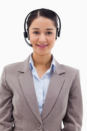 Portrait of a smiling operator posing with a headset against a white background Stock Photo - 11682604