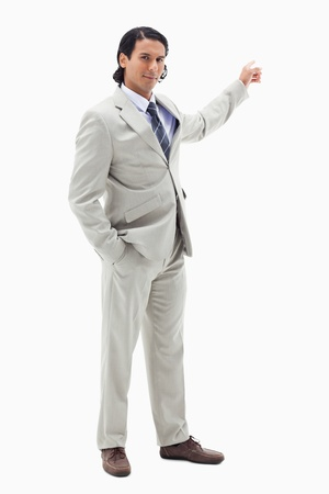 Portrait of a handsome businessman pointing at a copy space against a white background photo