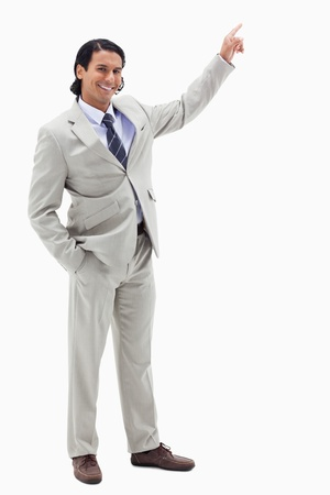 Portrait of a smiling businessman pointing at a copy space against a white background photo