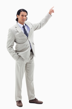 Portrait of a serious businessman pointing at a copy space against a white background Stock Photo - 11687407