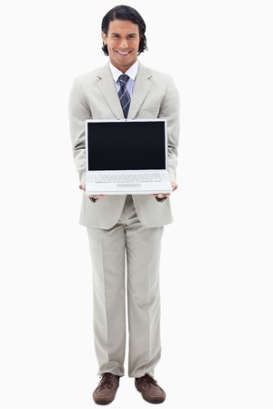 Portrait of a smiling businessman showing a notebook against a white background photo