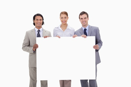 Businessteam holding blank sign against a white background photo