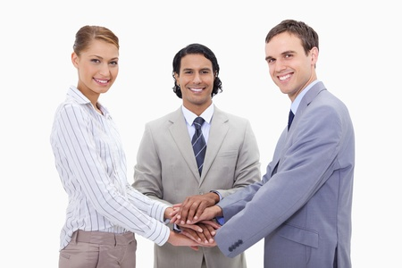 Businessteam motivating each other against a white background photo